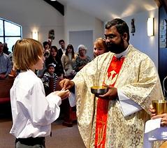 Catholic priest giving communion