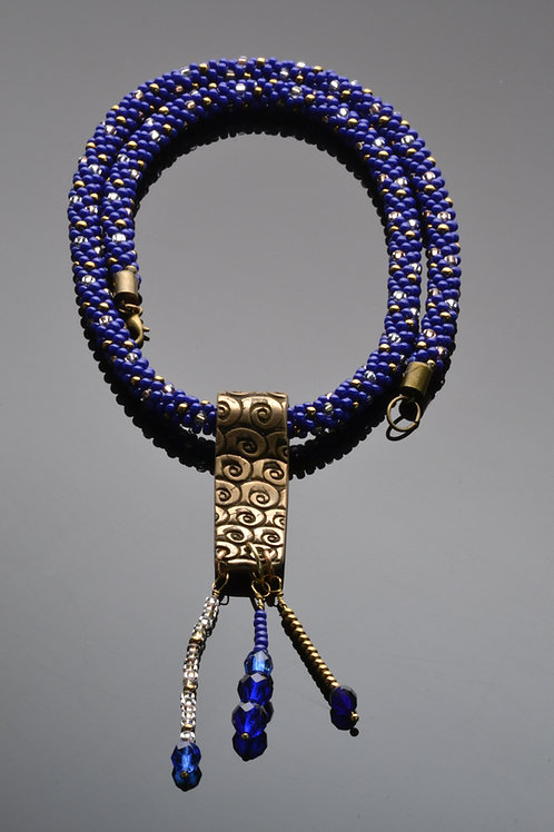 Blue beaded kumihimo necklace with bronze broach
