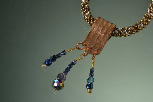 Bronze pendant with blue tone crystal beads on bronze tone kumihimo necklace
