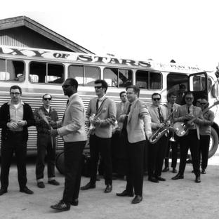 The Playtone Band and Bus on location