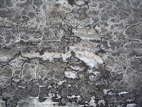 Salt on asphalt adds dramatic texture to artwork