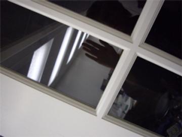 Hand reflection in studio window