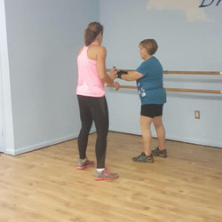 Allyson of Beat PD Branford works with a resistance band with me!_Allyson  initiated the class in Br