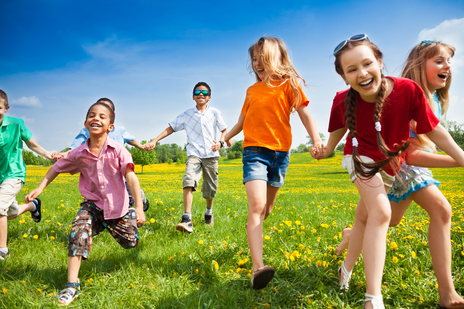 bigstock-Group-Of-Running-Kids-48113744.