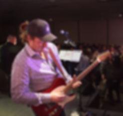Guitar over crowd_edited.jpg