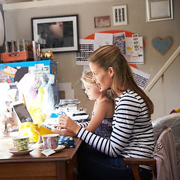 Mother working from home with daughter