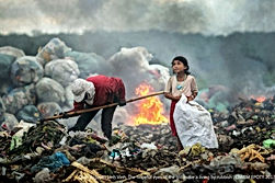 "Vietnam's Quoc Nguyen Linh Vinh, has won the Chartered Institution of Water and Environmental Management's Environmental Photographer of the Year (EPOTY) 2017 award.  ""The hopeful eyes of the girl making a living by rubbish"". Was taken in the waste dump of the city of Kon Tum in Vietnam, the poignant image captures a child and mother making a living from collecting waste.  Describing their experience taking the picture, Vinh said: ""The child was happy, looking at the dark clouds and chatting to her mother. This was so touching. She should have been enjoying her childhood and playing with friends rather than being there."""
