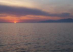 De sunset in de haven van Mykonos