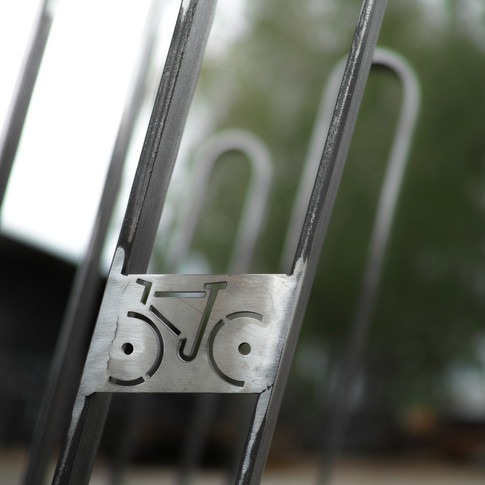 New bicycle stand Created as a cooperation with Czech street furniture company mmcité1.  Its functionality lays in a careful consideration for materials,  construction, price and simplicity of production. With a shape and function of the bike in mind, I tried to design a stand with ideal fixation of the bike and also easy and comfortable locking. There are three basic versions depending on number of parked bikes.  Material:  shaped steel construction anchored by stainless steel screws. The steel parts are equipped with a protective layer of zinc and powder coating.