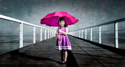 Girl On Jetty With Umbrella