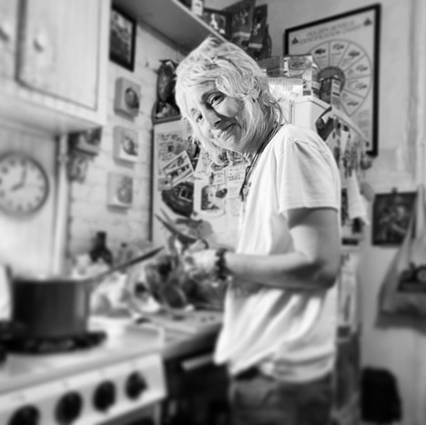 at home at the stove