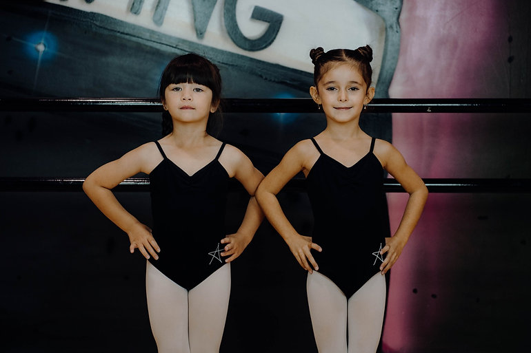 two girls in leotards getting ready for dance class in dance studio Adelaide