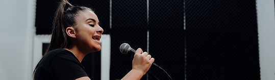 Solo singer in singing room holding microphone