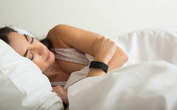 sleeping woman wearing biostrap.jpeg