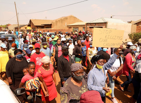 Residents of Orange Farm want a woman questioned who was found with murdered kids' clothes