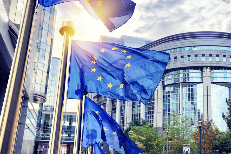 EU flags waving in front of European Par