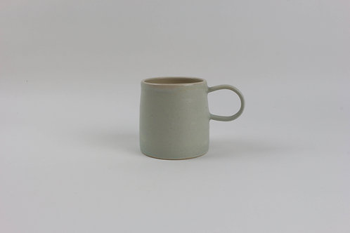Handmade Pottery craft mug made in Devon Torquay glazed in green peach blue white for tea and coffee
