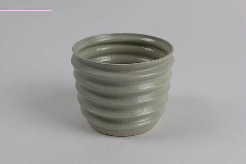 Christina Goodall Pottery thrown green pot wave shape