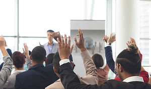 diverse-business-people-raising-hands-wh