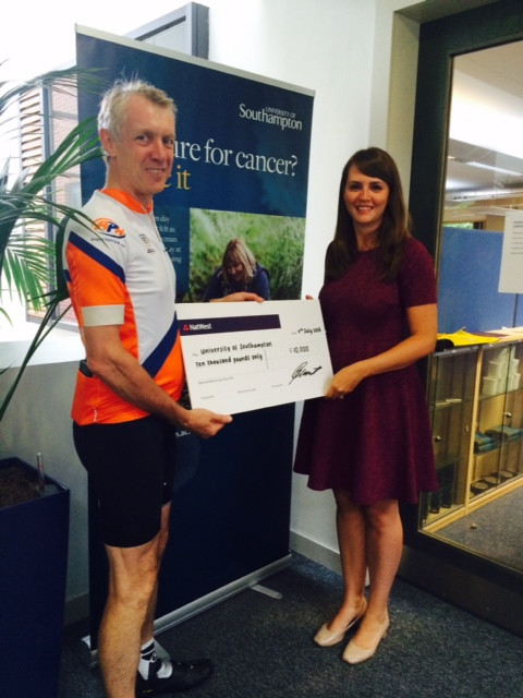 Nick Caunter handing over a £10,000 cheque to Centre for Cancer Immunology