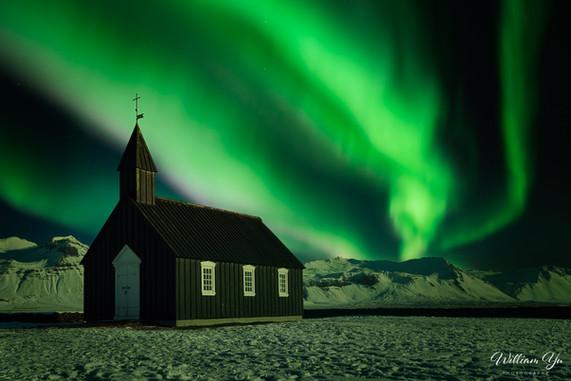 Aurora over a tiny church
