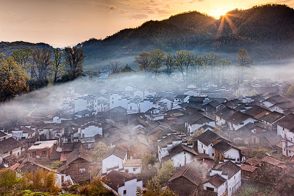 Sunrise over a village in Wuyuan