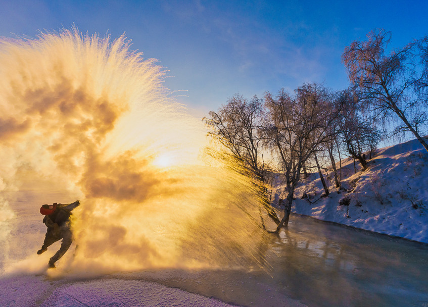 The warm water instantly turning into ice particles in an extremely cold January morning, Ulan Butong, Neimongo province, China