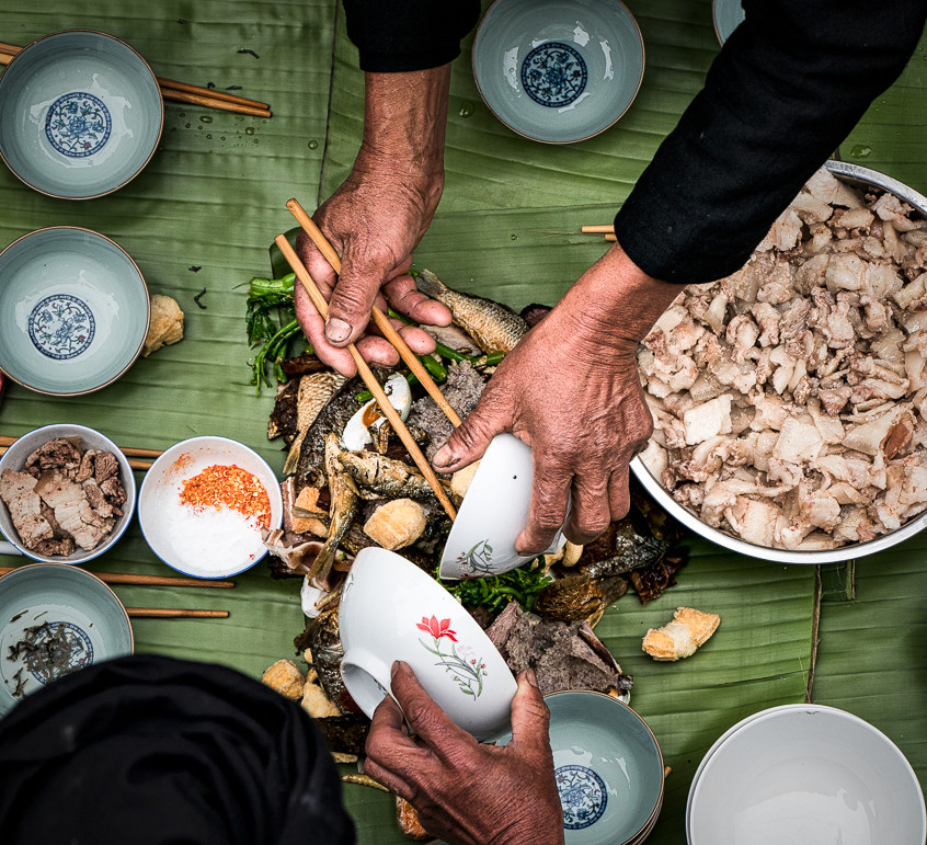 "Our photo tour group are lucky to be invited to the annual ""Long table feast"" ritual. Yuanyang, Yunnan province, China."