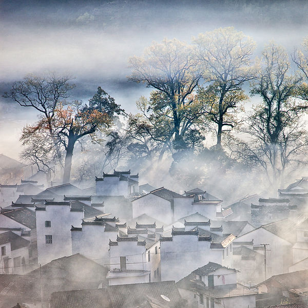 Sun rays shining on a village in Wuyuan