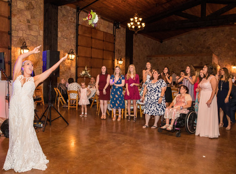 Our beautiful bride doing her bouquet toss to all of her single ladies!