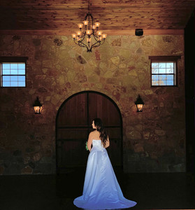 Such a beautiful bride posing or her bridals in our main hall in front of our medieval wooden doors!