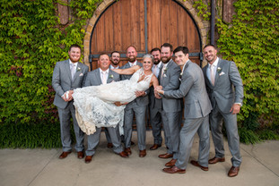 Such a fun photo! This bride had so much fun posing with her Groomsmen!