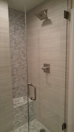 shower with inset and wall mosaic