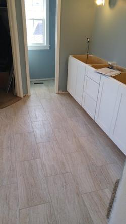 floor tile in master bathroom in progress