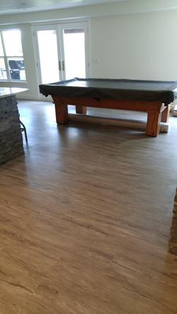 stone-look vinyl planks in basement