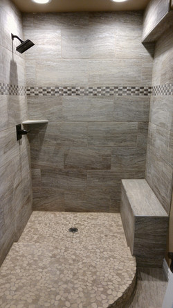 Stone look shower tile with custom step