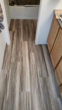 glue-down vinyl planks in bathroom
