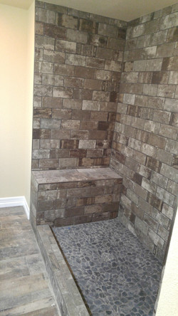 brick look tile shower in progress