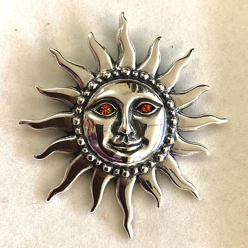Silver Sun pendant with Sapphire Eyes