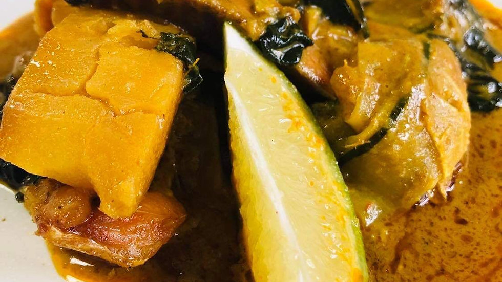 Yellow curry of salmon, with zucchini, spinach and potato