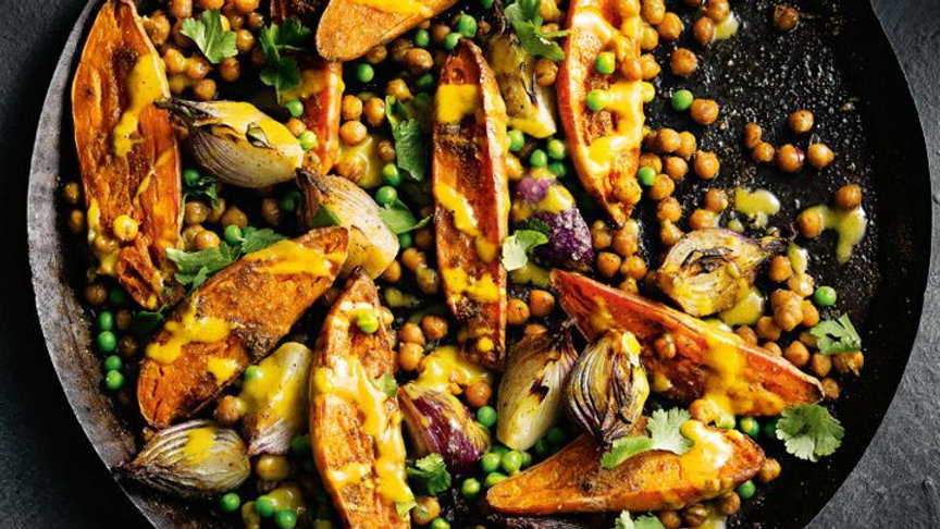 Spicy sweet potato and chickpea bake with tahini lime dressing