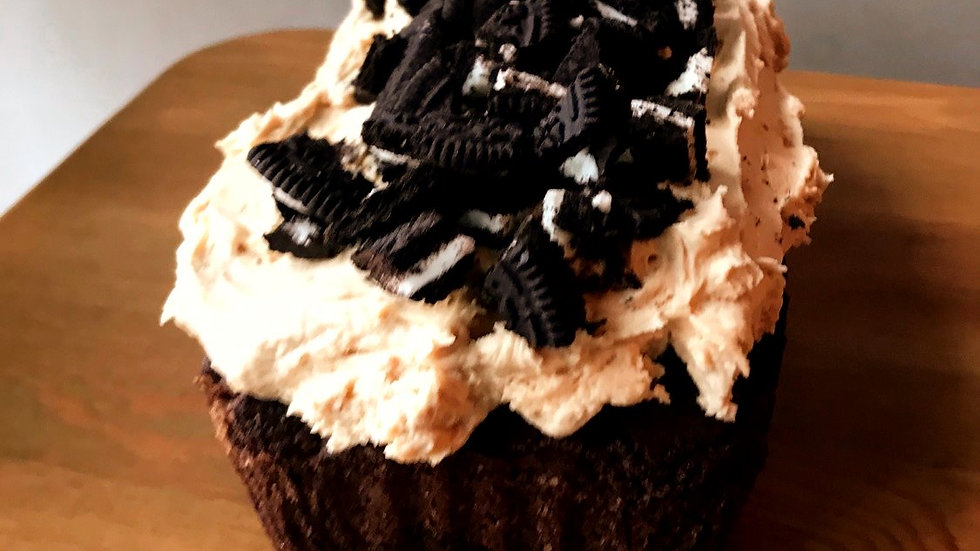 Choclate loaf with peanut butter frosting and Oreos