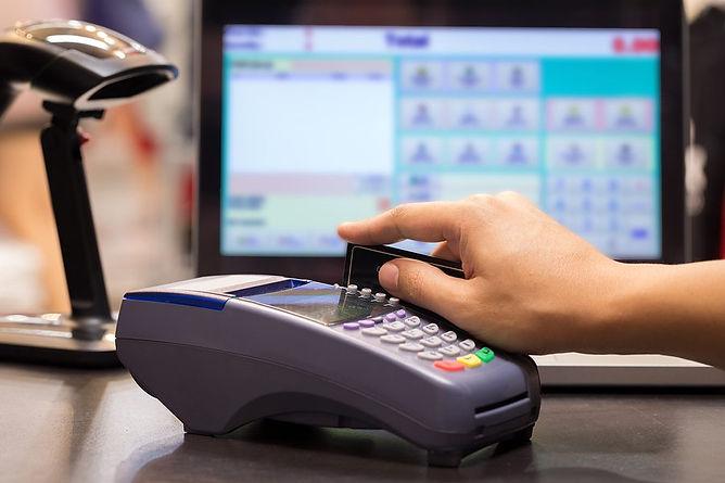 merchant-bigstock-Hand-Swiping-Credit-Ca