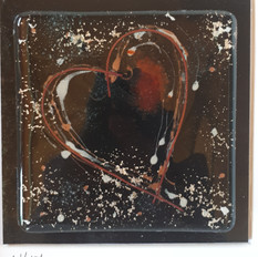 Black fused glass heart with copper inclusions framed 25x25cms  £25