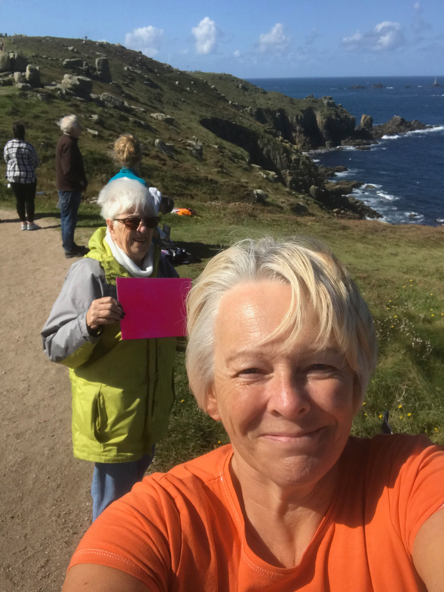 Standing on the coastal path to mark the painting line