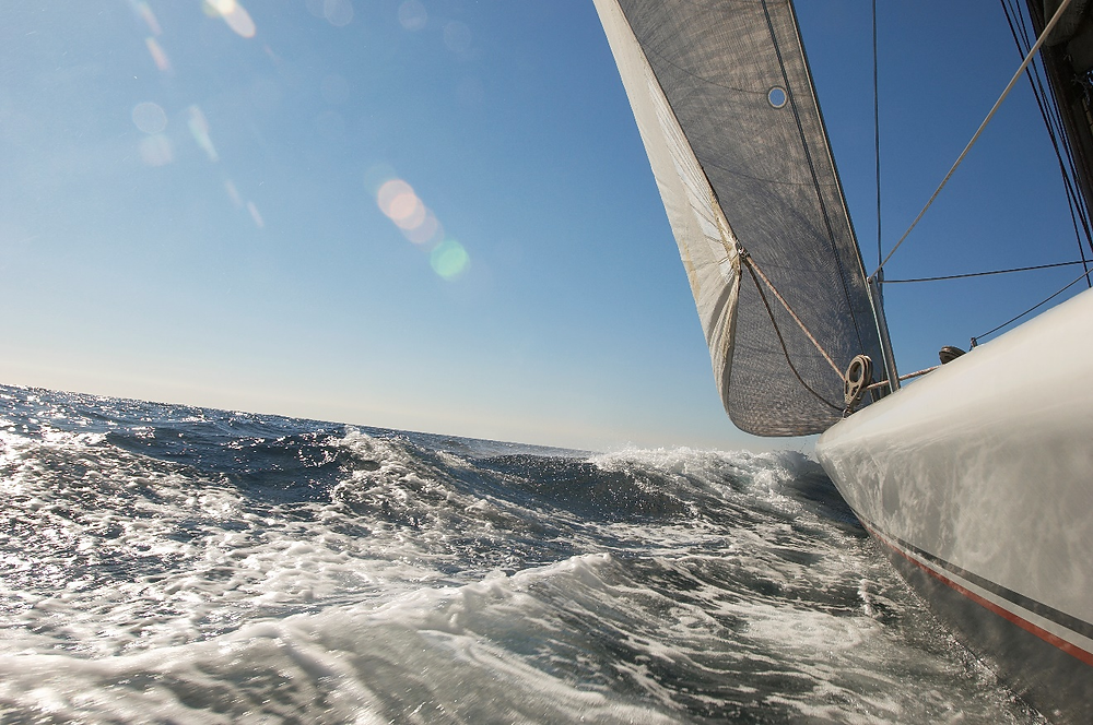 An HD cam view of a sailboat on the ocean