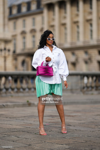 sarah-kpossa-wears-white-vintage-sunglasses-a-silver-chain-necklace-picture-id1334227970_s