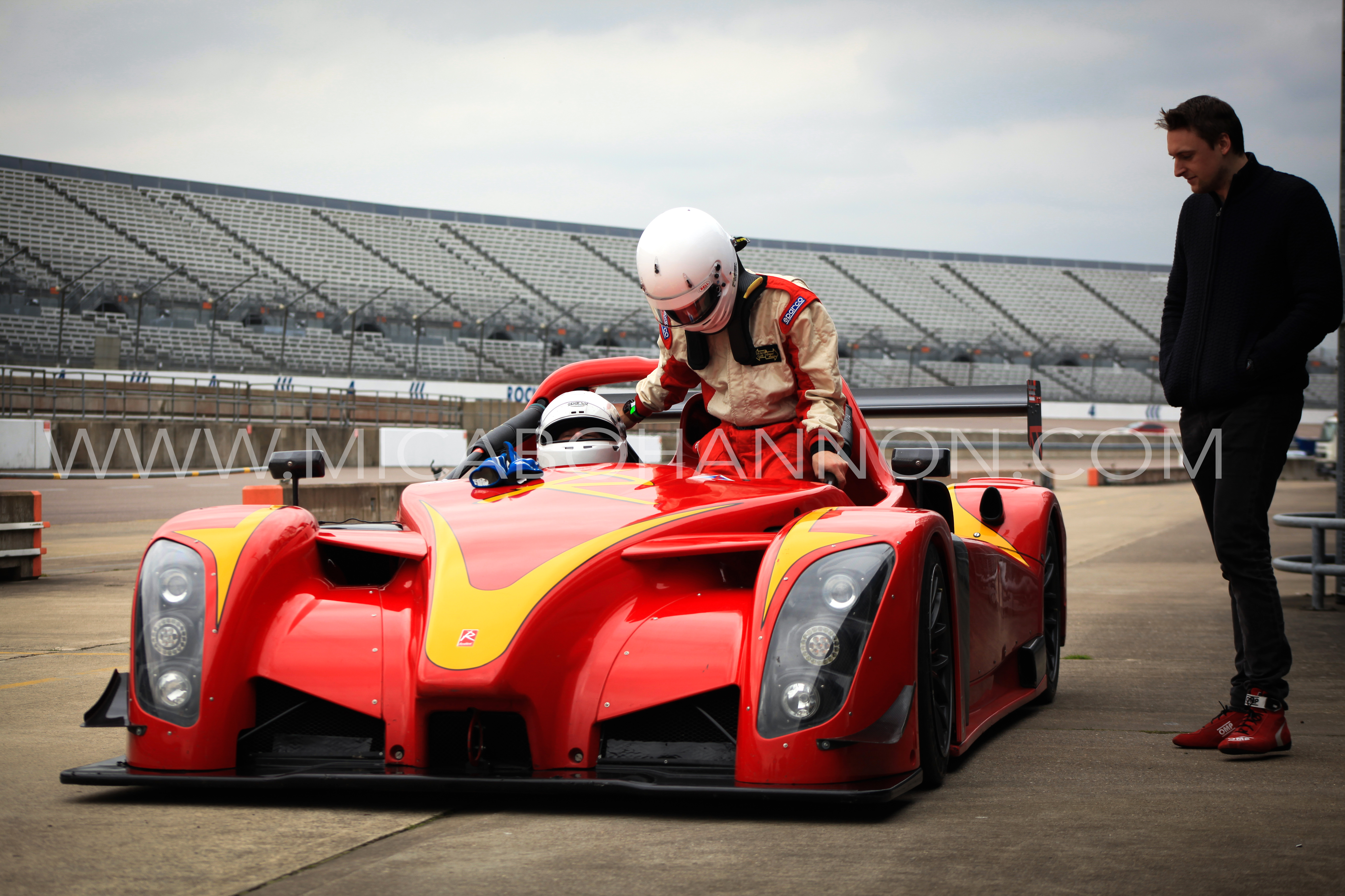 racing driver getting into radical