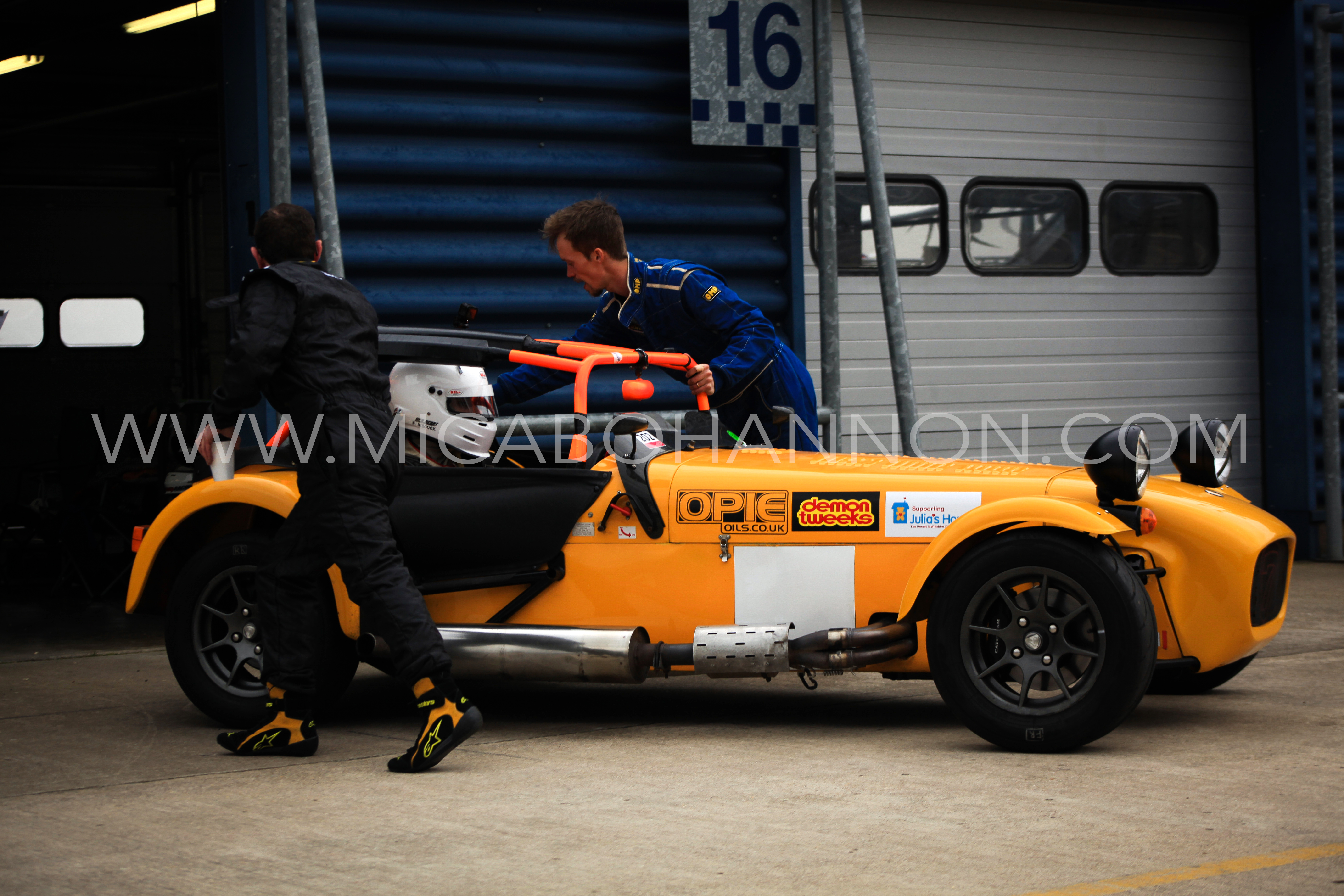 caterham coming out of pit garage
