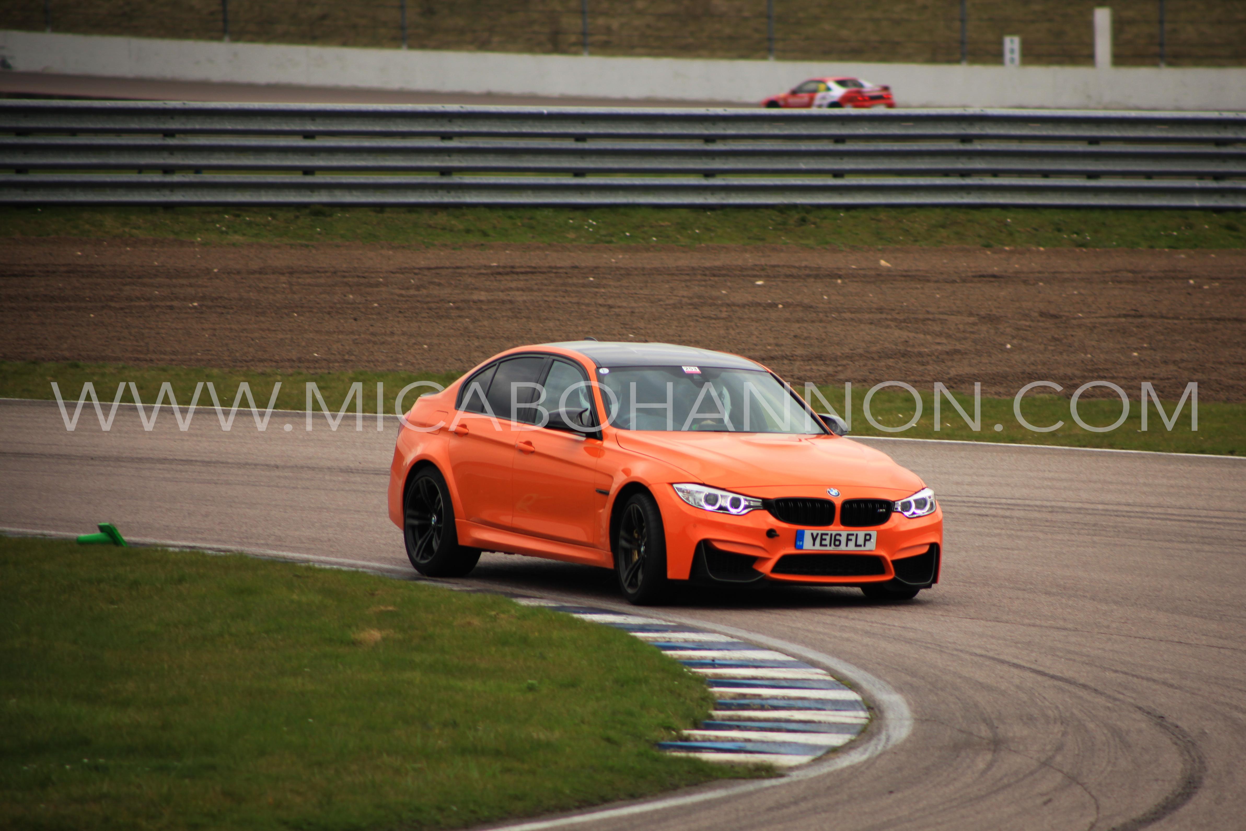 orange car racing round corner